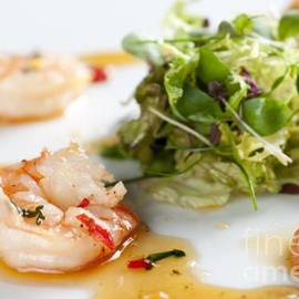 Andy Smy - KING PRAWNS GINGER CHILLI AND CORIANDER starter presented on a white background