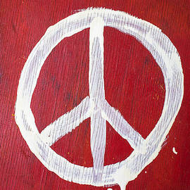 Garry Gay - Peace sign on red wooden wall