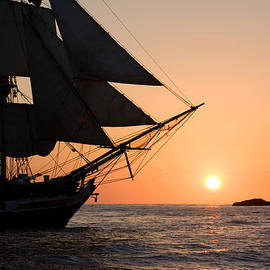 Cliff Wassmann - Silhouette of tall ship at sunset