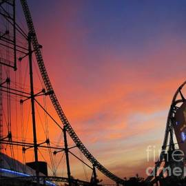 Eena Bo - Sunset Over Roller Coaster
