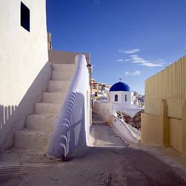 Cliff Wassmann - View of city of Oia on Santorini