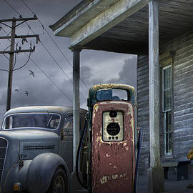 Randall Nyhof -  Man lost in thought by the Vintage Gas Station