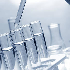 Test Tubes in Science Research Lab - Olivier Le Queinec