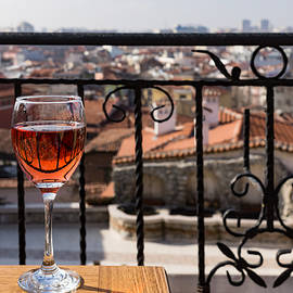 Georgia Mizuleva - A Dreamy Glass of Rose - Enjoying a Fabulous View from a Wrought Iron Balcony