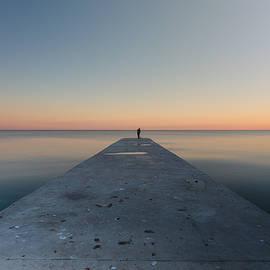 Pavel Gospodinov - A fisherman angling at sunset.