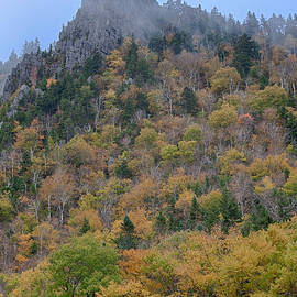 Jeff Folger - A pinnacle of rock stands tall over the fall colors of Dixville