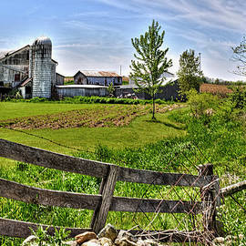 William Sturgell - A Weathered Barn Beyond the Fence