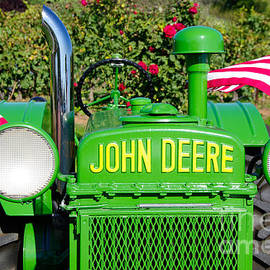 John Harmon - Antique John Deere tractor with American flags