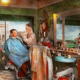 Mike Savad - Barber - Getting a trim 1942