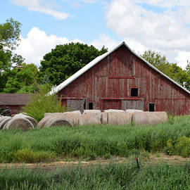 Kathy Krause - Barn With Round Bales