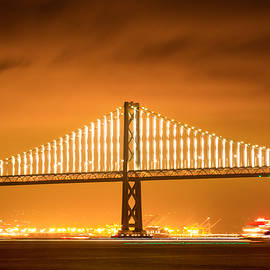 Bonnie Follett - Bay Bridge Span and Ferry at Night
