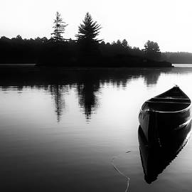 Karl Anderson - Black And White Canoe In Still Water