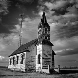 Jeff Swan - Black and white of an old church in front of a radio tower