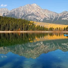 Larry Ricker - Blue Canoe on Patricia Lake