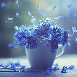 Ashraful Arefin - Blue Flowers In A Teacup With Petals Floating Around