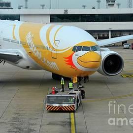 Imran Ahmed - Budget airline NokScoot jet airplane towed at Bangkok Suvarnabumi airport Thailand