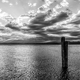 Yevhenii Volchenkov - BW Panoramic View On The Sunset Over Lake Garda Harbour in Italy