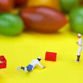 Paul Ge - Chef Tumbled in front of colorful tomatoes little people on food