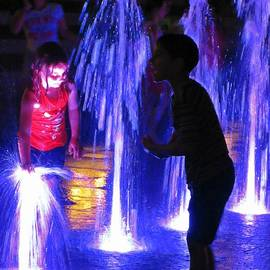Crystal Loppie - Children Playing in Beautiful Fountain Waters