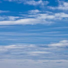 Cloud Streaked Blue Sky