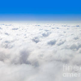 Clouds from Above and Blue Sky Horizon - Paul Velgos