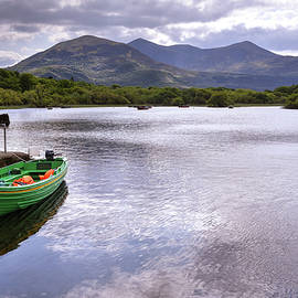 Bob Cuthbert - Colorful boat docked at the Ross Castle in Killarney Ireland