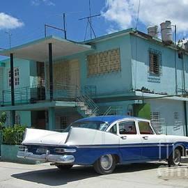 John Malone - Cuban Home with Car in Driveway