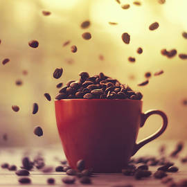 Ashraful Arefin - Cup Full Of Coffee Beans And Falling Coffee Beans