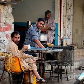 Imran Ahmed - Early morning tea and bread at street side stall Karachi Pakistan