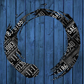 Enso Sign Made from Black Vintage Metal License Plates on Blue Wood Planks - Design Turnpike