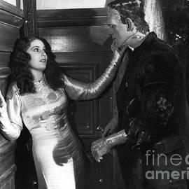 R Muirhead Art - Frankenstein and woman hit it of