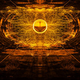 Golden Spinning Sphere Reflection - Pelo Blanco Photo