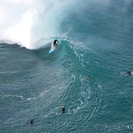Helicopter overviews of Flynn Novak surfing at Pipeline on the n - Sean Davey