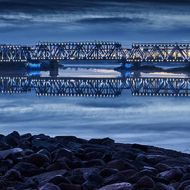 Valdis Veinbergs - Illuminated railway bridge at sunrise 1