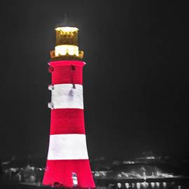 Sebastien Coell - Lighthouse at night