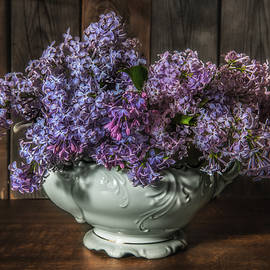 Lilacs in white china kettle