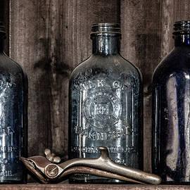 Teresa Wilson - Milk of Magnesia Bottles