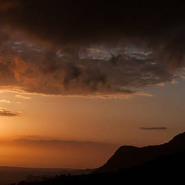Michalis Ppalis - Mountain range and dramatic sky during sunset