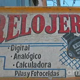 John Malone - Old Rolex Sign in Spanish