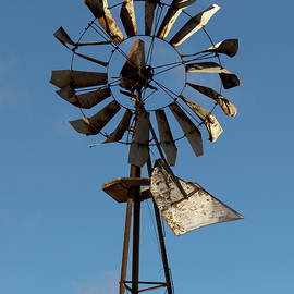 Mark A Brown - Old Windmill Against Blue Sky