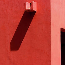 Prakash Ghai - Open Door and Water Outlet on a red wall
