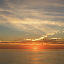 Georgia Mizuleva - Painted by Airplanes - Contrails Streak the Sky at Sunrise