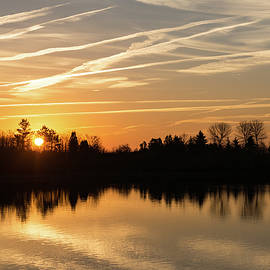 Georgia Mizuleva - Painted by Airplanes - Reflecting on Contrails Streaked Sunrise Sky at the Lake