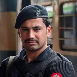 Imran Ahmed - Pashtun Railway Police officer stands guard at train Station Peshawar Pakistan
