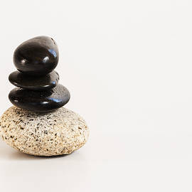 Vishwanath Bhat - Pebbles stacked on a white background