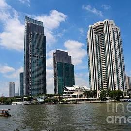 Imran Ahmed - Peninsula Hotel skyscrapers and boat across Chao Phraya River Bangkok Thailand