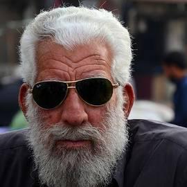Imran Ahmed - Portrait of Pakistani senior man in sunglasses Karachi Pakistan