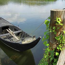 Carlos Caetano - Row Boat on the shoreline