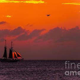 Claudia Mottram - Sailing boat at sunset