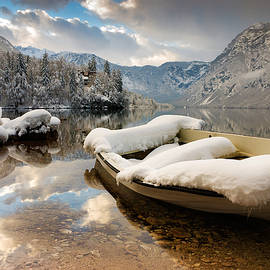 Ian Middleton - Snow covered boat on Lake Bohinj in Winter